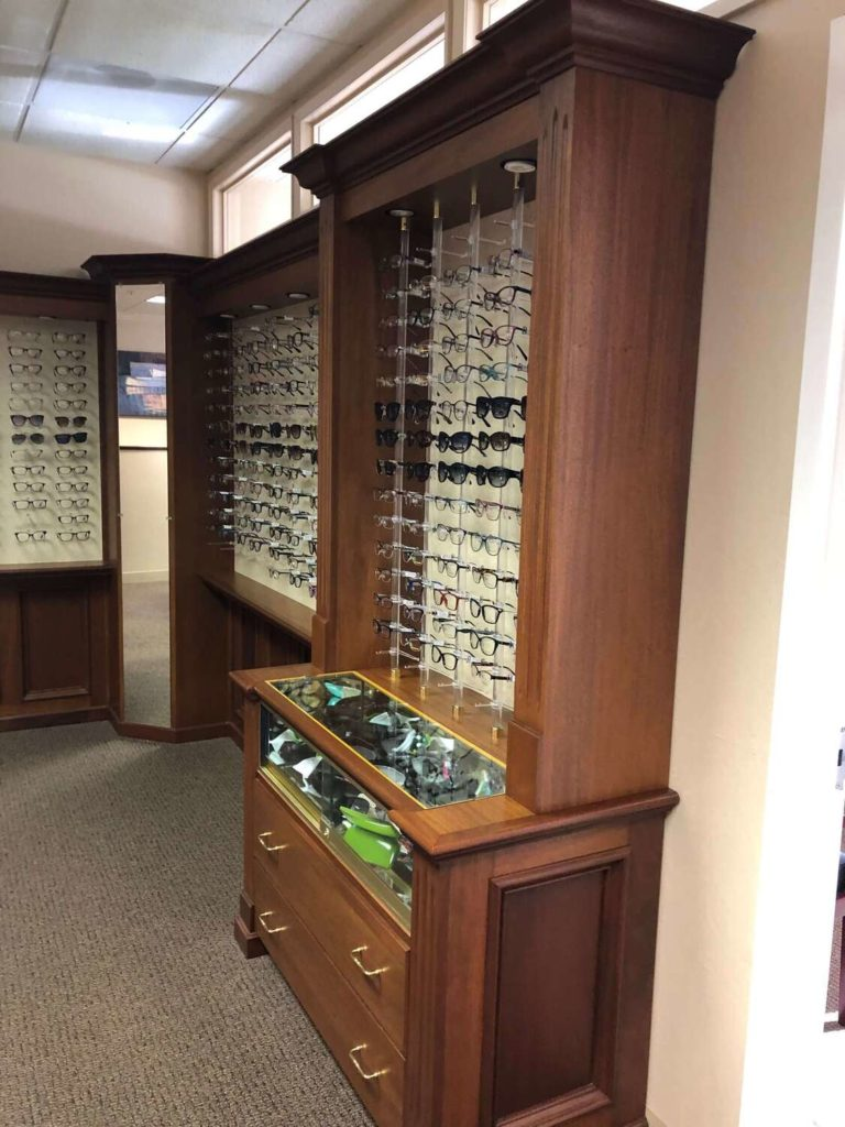 Fashion Optical Legacy Eyeglass Frame Displays – Medium Wood Finish 410 + Frames Includes 2 Dispensing Desks and small matching Cabinet.
